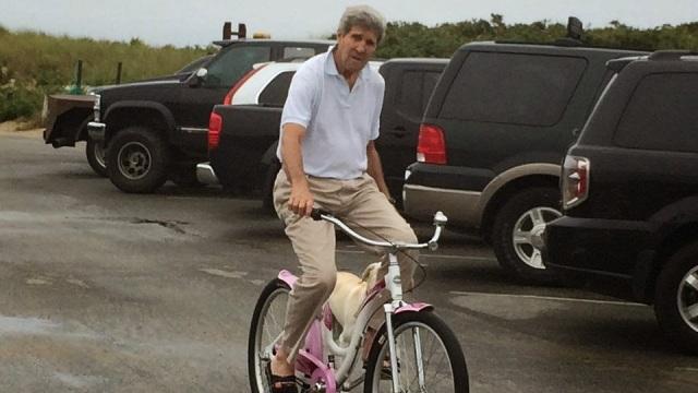 john-kerry-on-pink-bike-060814