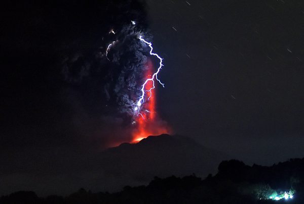 View from Frutillar, southern Chile, of lava spewing from the Calbuco volcano, on April 23, 2015. Chile's Calbuco volcano erupted on Wednesday, spewing a giant funnel of ash high into the sky near the southern port city of Puerto Montt and triggering a red alert. Authorities ordered an evacuation for a 10-kilometer (six-mile) radius around the volcano, which is the second in southern Chile to have a substantial eruption since March 3, when the Villarrica volcano emitted a brief but fiery burst of ash and lava. AFP PHOTO/MARTIN BERNETTI