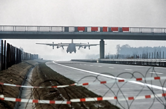 A C-130 Hercules aircraft lands on the autobahn.